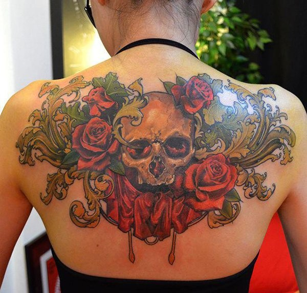 Stunning looking colored whole back tattoo of human skull and flowers