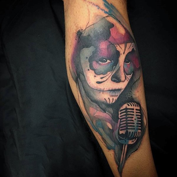 Stunning Mexican traditional singer tattoo on arm