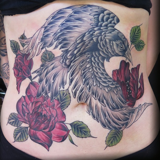 Stunning multicolored belly tattoo of dark bird and roses