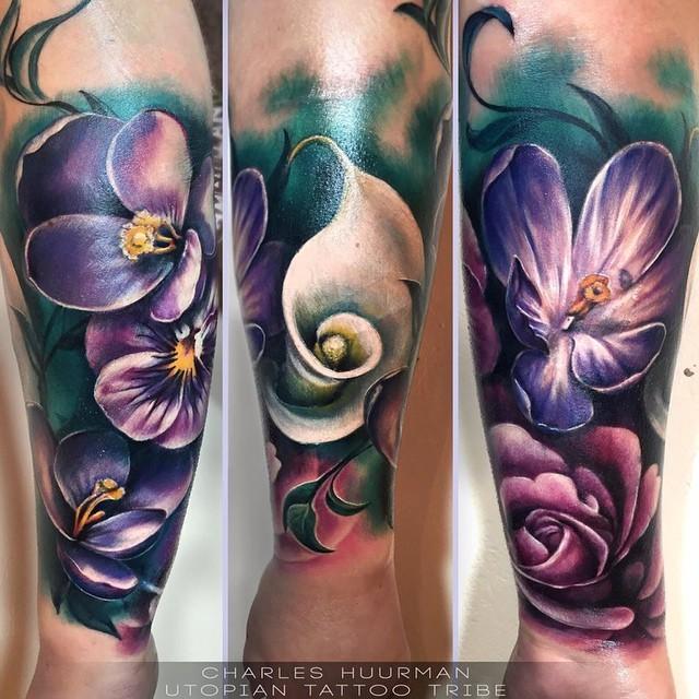 Stunning multicolored forearm tattoo of beautiful flowers