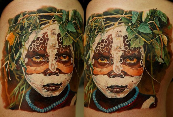 Stunning multicolored thigh tattoo of tribe child portrait with flowers