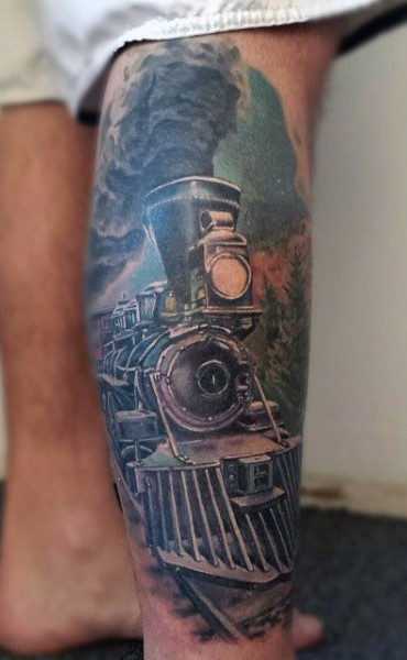 Stunning natural looking colored old steamy train tattoo on leg