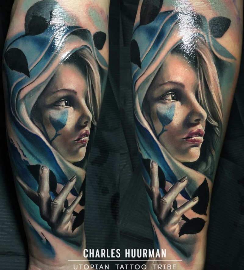 Stunning neo traditional style colored woman with hood and leaves tattoo on forearm