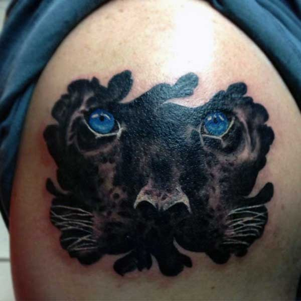 Stunning new school style colored shoulder tattoo of black panther with blue eyes