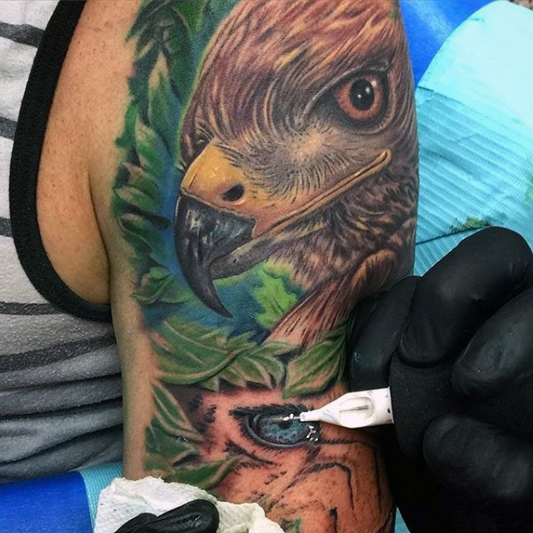 Stunning painted and colored unfinished wild life with eagle tattoo on arm