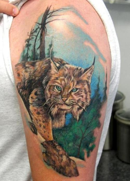 Stunning painted and colored very realistic wild cat tattoo on shoulder