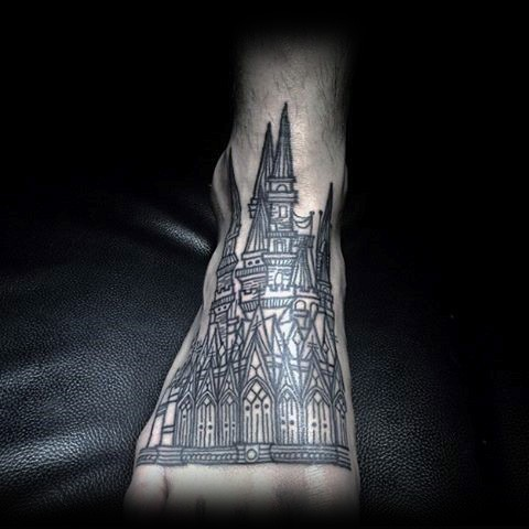 Stunning painted big old cathedral tattoo on foot