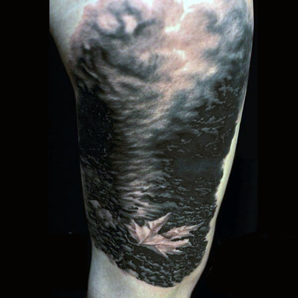 Stunning painted black and white little maple leaf in fog shoulder tattoo
