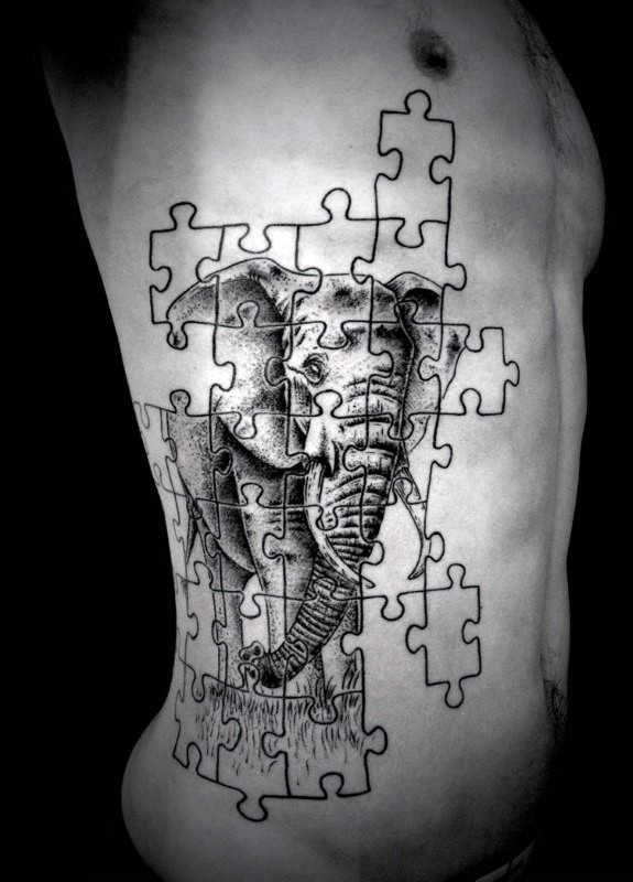 Stunning puzzle shaped black ink side creative tattoo stylized with elephant