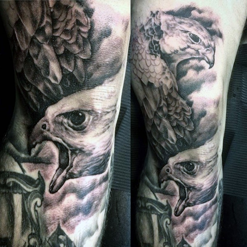 Stunning real black and white photo style large forearm tattoo of eagles