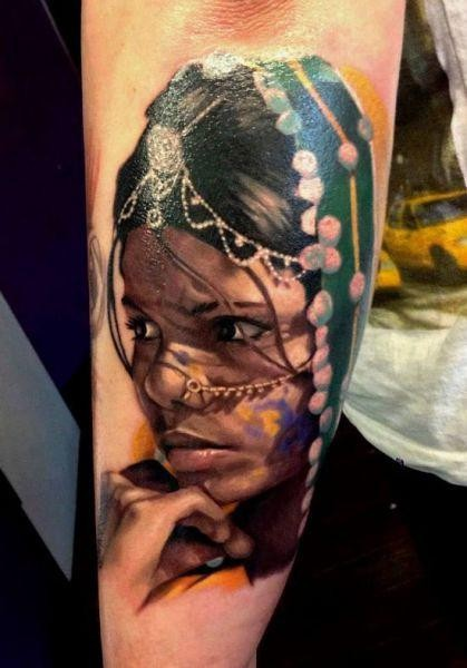Stunning realism style colored Indian woman portrait tattoo on forearm