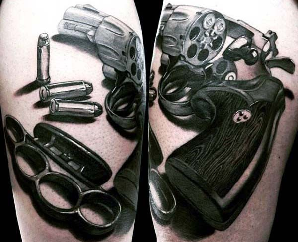 Stunning realistic designed big pistol with bullets tattoo on arm