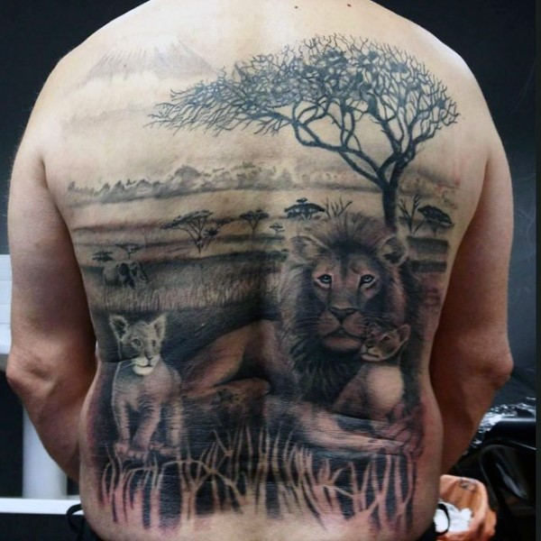 Stunning realistic looking black ink lion family in wild life tattoo on back
