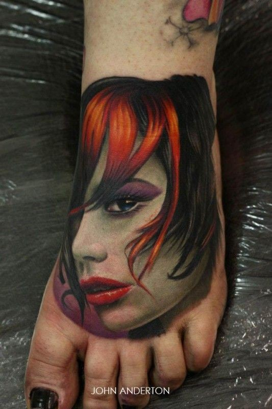 Stunning realistic portrait tattoo on foot by John Anderton