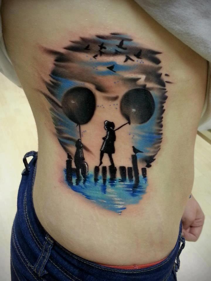 Stunning skull shaped children with balloons tattoo on waist
