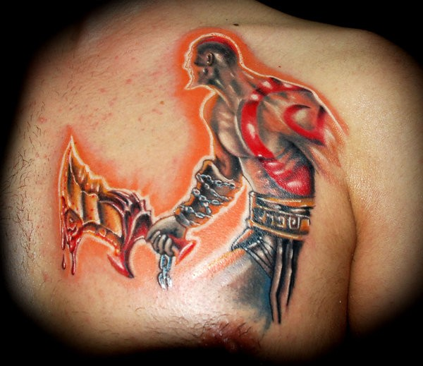 Stunning very cool colored video game barbarian tattoo on chest with big bloody sword