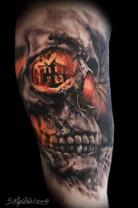 Stunning very detailed and colored mystical skull with burning house tattoo on shoulder