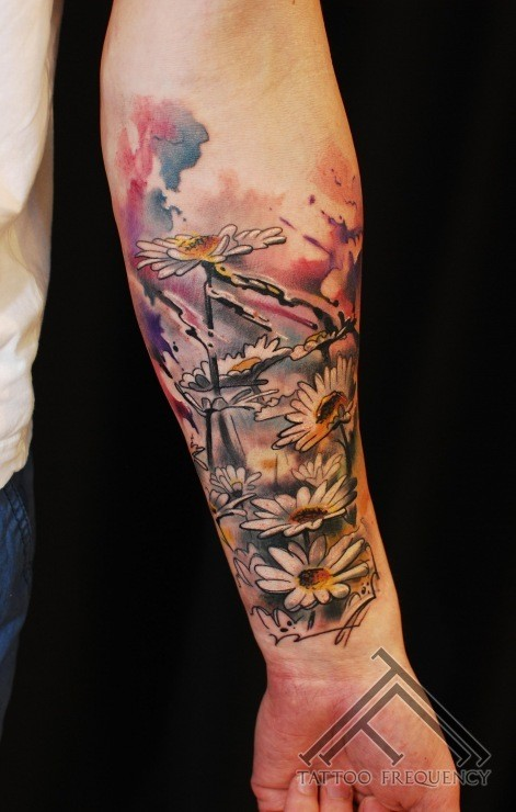 Stunning very detailed forearm tattoo of wildflowers