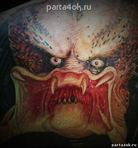 Stunning very detailed massive colorful on back tattoo of Predator face