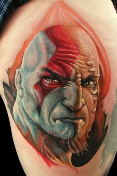 Stunning very realistic colored evil tribal man portrait on thigh tattoo