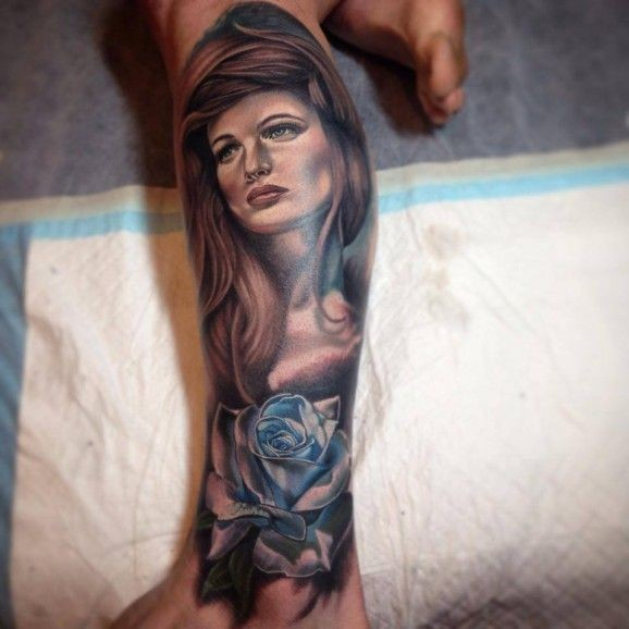 Stunning very realistic looking big woman portrait with flower tattoo on leg