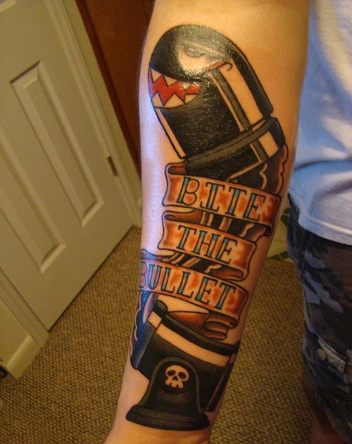 Stunning video game like colored bullet tattoo on forearm combined with lettering