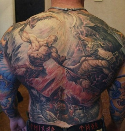 Stunning video game themed massive colored on whole back tattoo of fighting barbarian