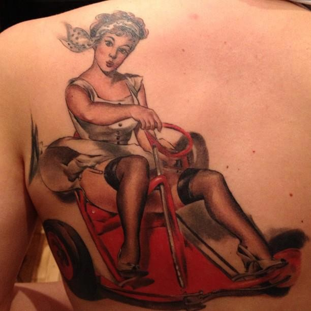 Stunning vintage style painted and colored sexy woman tattoo on shoulder