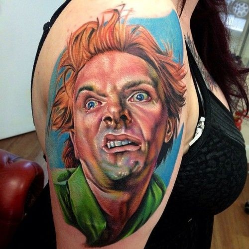 Stupid looking colored shoulder tattoo of man portrait