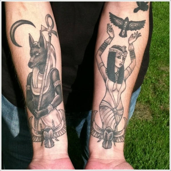 Stylish black ink various Egypt Gods tattoo on forearms
