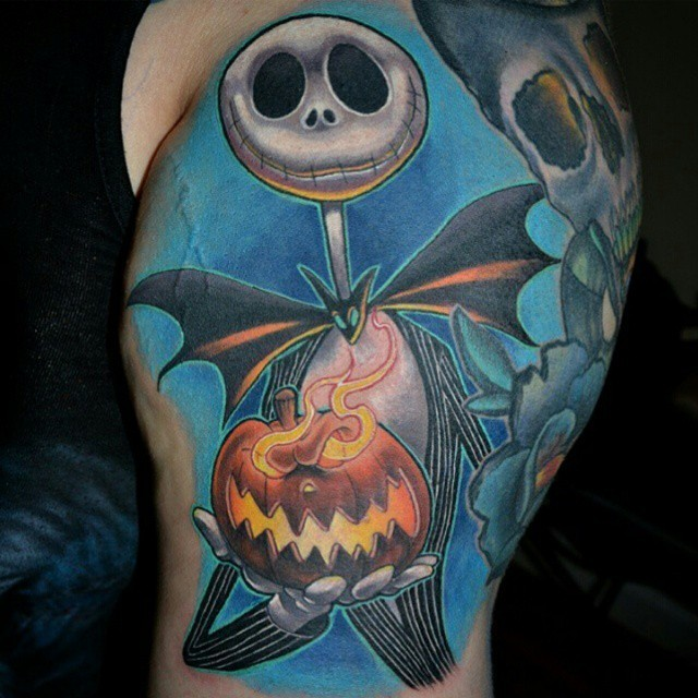 Stylish colored shoulder tattoo of Nightmare before Christmas main hero with pumpkin