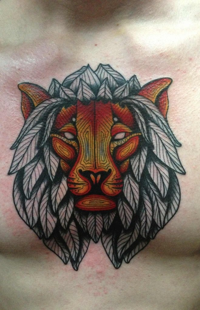 Stylized tiger head tattoo on chest