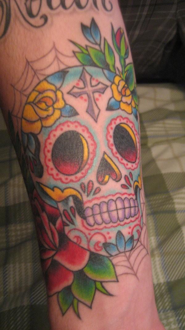 Colourful sugar skull on arm