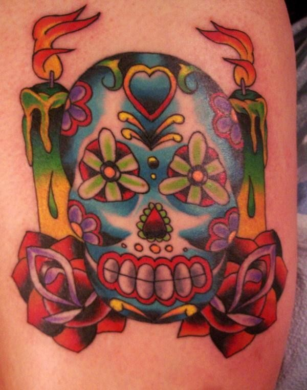 Sugar skull with burning candles tattoo