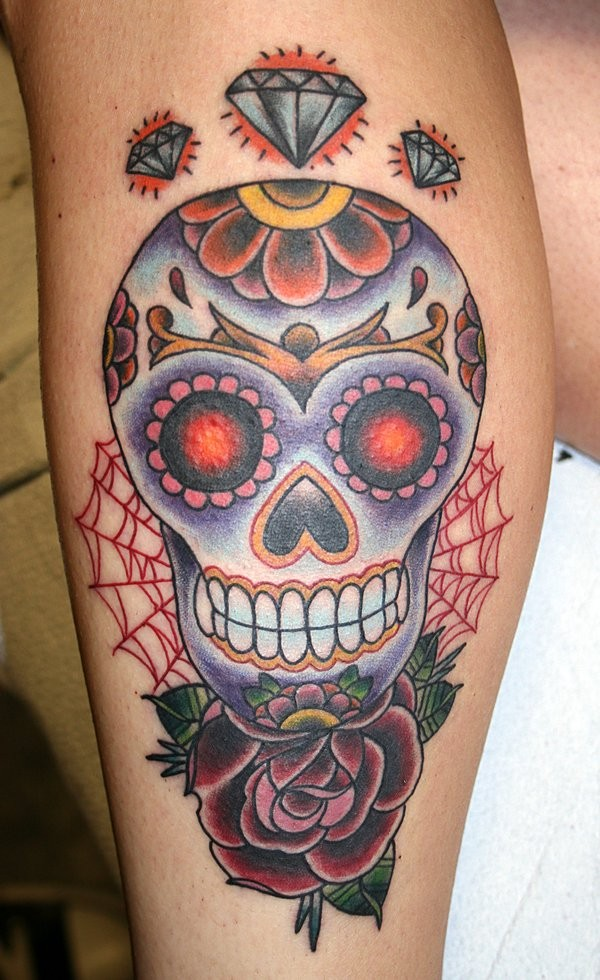 Sugar skull with rose web and diamonds tattoo