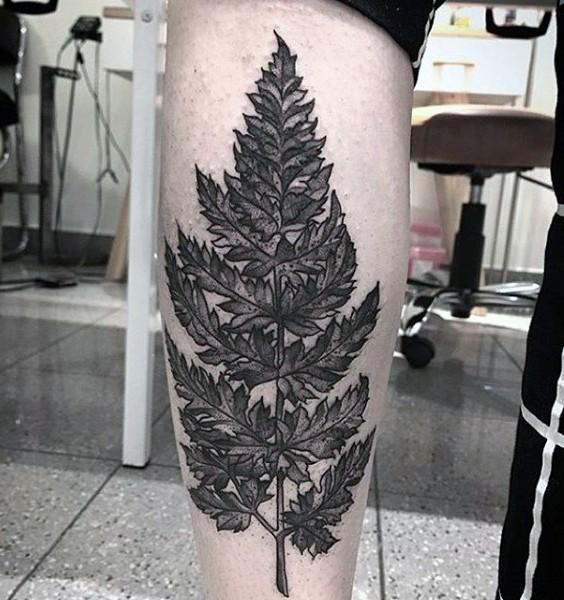 Super realistic and detailed fern leaf tattoo on arm