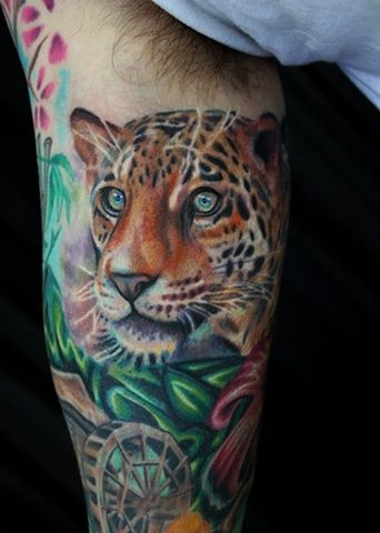Super realistic leopard head tattoo on arm by Dave Wah