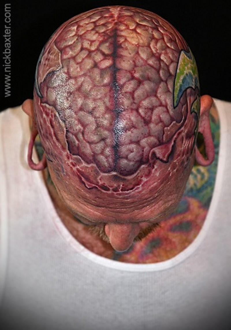 Super realistic naturally colored human brain in torn ripped skin realistic skull tattoo