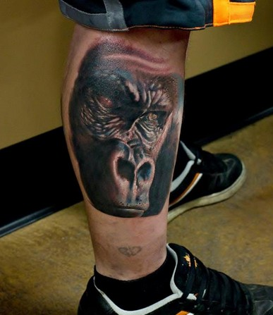 Super realistic portrait of a gorilla tattoo on leg
