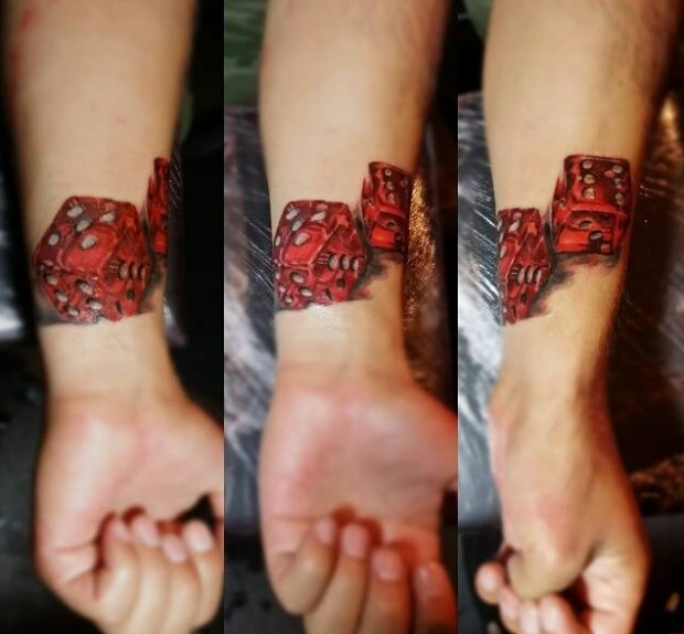Super realistic red dices wrist tattoo
