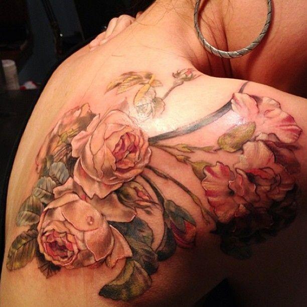Super realistic roses tattoo on shoulder