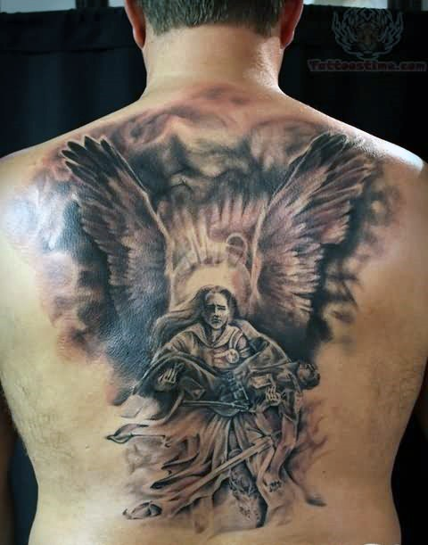 Superior black and white detailed angel holding fallen warrior tattoo on upper back