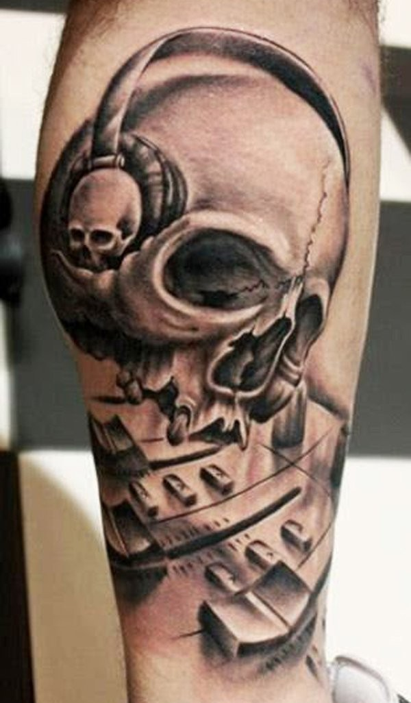 Superior black and white leg realism style leg tattoo of demonic human skull with headset