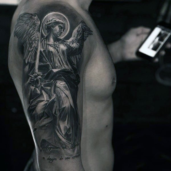 Superior black and white shoulder tattoo of angel warrior with great sword and lettering