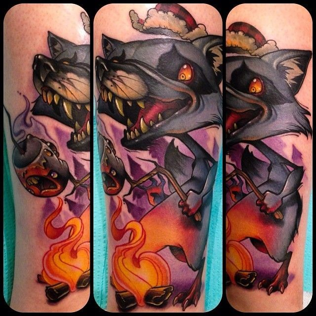 Superior cartoon style colored funny wolf  with fire tattoo