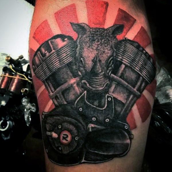 Superior colored bike engine with rhino head tattoo on arm