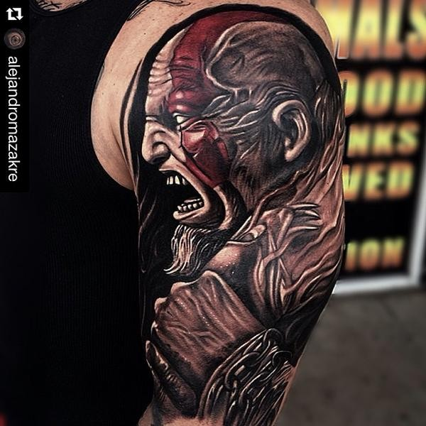 Superior colored shoulder tattoo of barbarian with chain