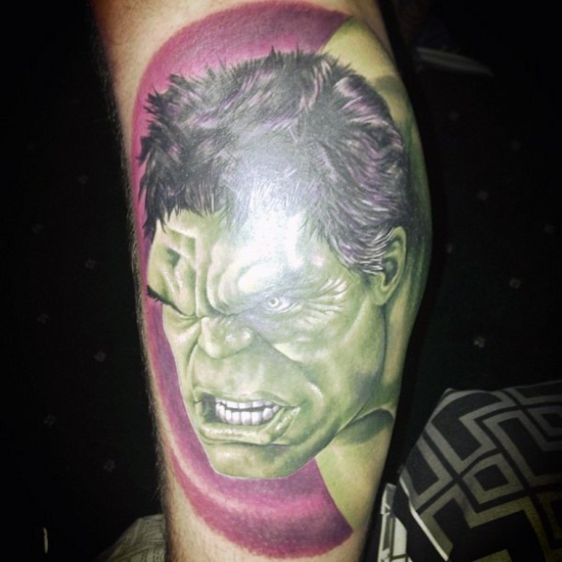 Superior detailed and colored big leg tattoo of angry Hulk head