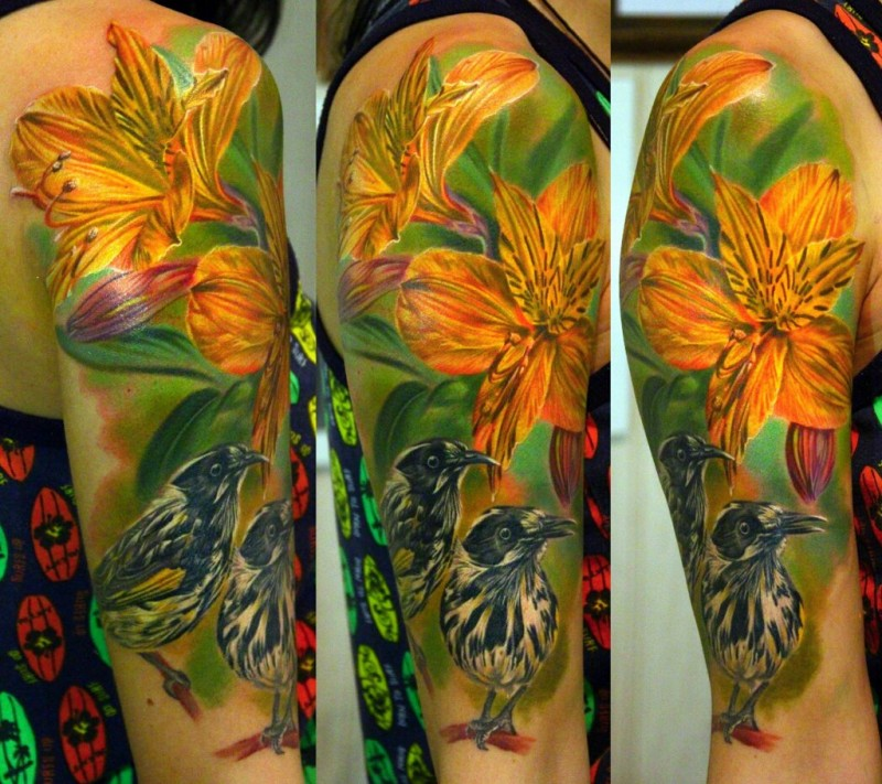 Superior detailed and colored realism style shoulder tattoo of beautiful flower and birds