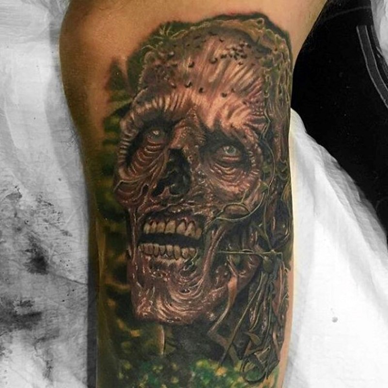Superior detailed colored big monster face tattoo on leg